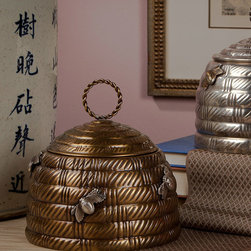 Antique Brass Bee Box - Traditional motifs reinvented with the unabashed charm of transitional d�cor , the Antique Brass Bee Box is a lidded metal pot formed into the iconic domed shape of a beehive attended by a few plump worker bees that hover over the walls.  The lid of the textured hive can be lifted with an airy braided-ring handle.  This neat, imaginative accent is especially perfect for the nursery or the kitchen.