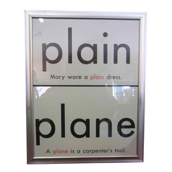 Framed Homophone I - Plain/Plane - Plain - Plane: 1960's era educational graphics.Framed in a minimal brushed metal finish with glass, these nostalgic grammar school teaching aids look great hung individually or in groups.