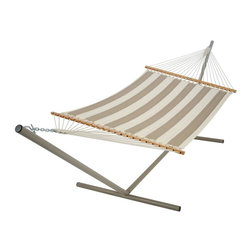 Pawleys Island Hammocks - Pawleys Island Regency Sand Large Quilted Sunbrella Fabric Hammock Multicolor - - Shop for Hammocks from Hayneedle.com! Additional features Zinc-plated hanging hardware includes 2 tree hooks and 2 S hooks Beige-colored ropes of all-weather fade-resistant DuraCord Synthetic rope has the look and feel of cotton Sunbrella fabric resists fading staining rot mold and mildew Polyester fiberfill batting for a cushiony soft surface Hammock stand sold separately Weight capacity: 450 lbs. Overall length: 13 feet Overall dimensions: 13L x 4.5W feet Includes 1-year warranty Even without sand in your backyard the Pawleys Island Regency Sand Large Quilted Fabric Hammock transports you to a relaxing beach setting. This durable quilted fabric hammock from Pawleys Island evokes a sense of seaside leisure with its sand-colored hues. The hammock is crafted from two layers of all-weather solution-dyed cotton-soft Sunbrella fabric with stripes of vellum and heather beige. White-oak spreader bars are hand-dipped multiple times in honey-gold marine spar varnish and the DuraCord ropes offer lasting strength. About SunbrellaSunbrella has been the leader in performance fabrics for over 45 years. Impeccable quality sophisticated styling and best-in-class warranties prove the new generation of Sunbrella offers more possibilities than ever. Sunbrella fabrics are breathable and water-repellant. If kept dry they will not support the growth of mildew as natural fibers will. Beautiful and durable Sunbrella is a name you can trust in your outdoor furniture. Cleaning and Caring for SunbrellaRegular maintenance is the best way to keep your Sunbrella fabrics looking good and delay deep vigorous cleaning. Brush off dirt before it becomes embedded in the fabrics and wipe up spills as soon as they occur. For light cleaning use a mild soap and water solution and a sponge allowing your cleaning solution to soak into the fabric. Rinse thoroughly to remove all soap residue and allow fabric to air dry. For more specifics on maintaining Sunbrella fabrics visit Sunbrella.com. About Pawleys IslandIn 1889 the Original Pawleys Island Rope Hammock was created at Pawleys Island one of the oldest summer resorts on the South Carolina coast. When river boat pilot Captain Joshua John Ward found the grass-filled mattresses on his boat too hot in the summer he decided to make a cool and comfortable cotton rope hammock to use on his boat. After several uncomfortable designs Cap'n Josh made a hammock using wooden spreaders without knots. This original design has proven to be so comfortable that it's still used in Pawleys Island's popular hammocks over a century later. Pawleys Island continues to use the highest-quality materials when making its traditional all-cotton rope spun polyester rope and DuraCord hammocks. The custom-designed stretcher bars are cut from seasoned Carolina red oak then steamed bent drilled sanded and varnished to impart a comfortable sway to the hammock and to spread the rope evenly for optimum stability. The people of The Original Pawleys Island Rope Hammock are incredibly proud to be anything but new-fangled. Now 120 years old and counting they continue to offer the very best of their past hoping it will help you better enjoy your future.