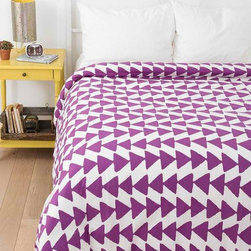 Magical Thinking Triangle Chain Duvet Cover, Purple - The alternating rows of triangles on this comforter from Urban Outfitters come in the 2014 Pantone Color of the Year, Radiant Orchid. This works beautifully with the sunny yellow they have it paired with, if you're trying to incorporate the color in your home.