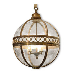 Kathy Kuo Home - Jordan Global Bazaar Round Antique Brass Pendant Lantern - Large 3 Light - A glowing globe detailed with antique brass adds a generous dose of Global Bazaar panache to your entryway, dining room or sitting area. Three lights illuminate this lustrous, antique brass hanging lantern. Gilded circles surround the equator of the shining sphere, casting intriguing shadows on the surrounding space.