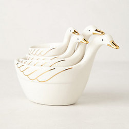 Measuring Gaggle - Small gold details go a long way. These swan measuring cups look much more expensive than they are. Plus, they are cute when kept out on your kitchen counter.