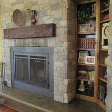 Mediterranean Fireplaces by Custom Homes by Miller