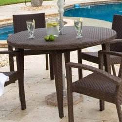 Hospitality Rattan - Soho Patio Woven Dining Table 48 in. Round in - This patio dining table is made for outdoor use and is expertly constructed from all weather wicker and aluminum for years of use without fading or rusting. Features tapered legs and a java finish to maximum style, especially when paired with coordinating items. Color shown is not accurate . See additional image as an example of the EXACT product color. This product is warranted for outdoor use. Outdoor wicker dining group. Rehau Fiber java brown finish. Includes umbrella hole. Weather and UV resistant. Plexiglass is used as support underneath wicker weave. Sturdy aluminum legs for extra support. Some assembly required. 48 in. W x 48 in. D x 31 in. H (40 lbs.)The Soho Collection is a sleek contemporary collection that offers a unique see-through modular sectional that allows endless possibilities ranging from a sofa, loveseat, armless chair setup, to a standard sectional. The Soho Collection offers a fully anodized aluminum frame, which is then woven with Rehau Java Brown fiber. Its unique look and multi-colored textured surface make it one of the most attractive collections for outdoor use. The Soho Collection only requires cushions for the seating pieces. The balance of the collection can be used without cushions. In addition, glass is optional as the table tops are fully woven and offer reinforced plexiglass undersides for enhanced sturdiness. The large round dining table accommodates an umbrella. The Soho armchair and chaise lounges are all stackable items. The cushions used on the Soho collection are available with synthetic outdoor fabrics including Sunbrella. Most importantly the quality of the Soho collection makes it ideal for contract settings.