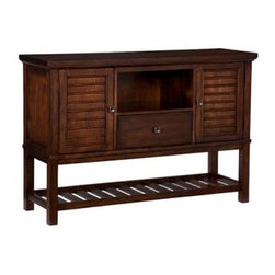 Legacy Delaney Credenza Server - The Legacy Delaney Credenza Server brings an air of casual tropical style to transitional interiors, with shutter-like doors, a slatted bottom storage shelf, and okoume mahogany veneers in a handsome, burnt auburn finish. Constructed from poplar solids, this serving and storage piece contains a wine shelf and removable shelves, as well as an open storage area.About Legacy Classic FurnitureCommitted to offering the best of today's youth-bedroom styles for the young and young at heart, Legacy Classic Furniture offers a wide selection of best selling designs and finishes with a large variety of beds and storage and study options. Dedicated to providing outstanding quality at reasonable prices, Legacy Classic Furniture employs quality materials, proven construction techniques, and the highest safety standards to manufacture exceptional products that are built to last a lifetime.Note about drawer features:All Legacy products use Kenlin's Rite-Trak drawer guide system. Exceptionally quiet and smooth, this system features positive stops and close tolerances for better drawer fit. Kenlin drawer guides are made with precision steel guides and runners, permanent lubrication, and specially engineered plastic components for years of reliable performance.
