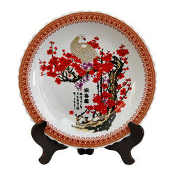 Oriental Unlimited - 14 in. Dia. Cherry Blossom Porcelain Plate - Chinese decorative charger, for dry use only. Often displayed upright on a folding wood stand. Beautiful decorative display on a buffet, server or break front. This item is shot with the stand for illustration purposes, the stand is sold separately. Please select the 14 in. size of Rosewood Plate Stand.. 14 in. Dia. x 2 in. H (5.5 lbs.)