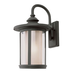 Trans Globe - Chimney Stack Outdoor Wall Lantern - Chimney Stack Outdoor Wall Lantern features Tea Stain Clear double round glass shades with weather resistant cast aluminum powder coat finish in Black available in three sizes.  Available in a wall, pendant and post top version.  Small size is 7.5 inches wide x 13 inches high x 9 inches deep and requires one 100 watt 120 volt A19 incandescent lamp not included.  Medium size is 9 inches wide x 15.5 inches high x 11 inches deep and requires one 100 watt 120 volt A19 incandescent lamp not included.  Large size is 11.5 inches wide x 19.25 inches high x 13.5 inches deep and requires one 100 watt 120 volt A19 incandescent lamp not included.