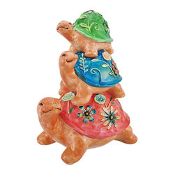 Outdoor Tortoise Family Stack Garden Statue - Add a colorful accent to your garden with this tortoise statue. It features a family of 3 tortoises, all stacked up with nowhere to go! Made of cold cast resin, this piece measures 12 inches tall, 10 inches long, and 6 1/2 inches wide. Its bold, bright colors are lovingly hand painted for a whimisical effect, and are sure to be noticed. This statue is suitable for indoor or outdoor use, and makes a great gift.