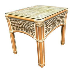Spice Island Wicker End Table - Nothing steps up the elegance of your living area or sunroom like the Spice Island End Table. The beveled glass top showcases the beauty of woven, natural-finish wicker with rattan and banana bark rope detail, while an arched apron adds to the table's cool, laid-back charm. Perfect for displaying your favorite lamp or for keeping your magazines handy, this end table sports a sturdy rattan frame for years of enjoyment.Recommended use: This end table is not designed for outdoor use. It is constructed of natural materials and will not withstand the elements. It's for indoor or sunroom use only.