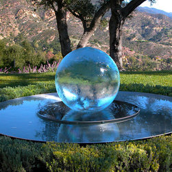 My Garden in Santa Barbara - A photo of the aquaspere - or sphere fountain that I placed in my garden at my home in Santa Barbara. Photo by Allison Armour