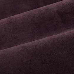 Princess Upholstery Fabric in Purple - This dark purple upholstery fabric has a suede and velvet-like pile that creates a decadent feel that's not easily forgotten. Super durable, yet soft and luxurious, this fabric is perfect for high traffic areas. Available in a multitude of colors, this fabric is a great solid to use as the basis for any design. Ideal for reupholstering chairs, sofas, ottoman, and more, or for creating custom bedding and pillows. Made from 100% polyester. Fire Rating: UFAC Class 1. 100,000 double rubs. Width: 54″. Additional yardage may be purchased on back-order.