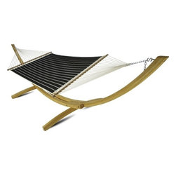 """Hatteras Hammocks - Large Quilted Hammock - Classic Black Stripe - Classic and classy, like a highly tailored tuxedo for your favorite patch of yard. Striking in simplicity and sophistication, this straightforward pattern's strong, clean lines compellingly compliments its most-basic color scheme. On closer inspection, the thin white bands give way on one side to angled hash-marks, adding an understated dash of casual. With two pillowy layers of best quality all-weather outdoor DuraCord® fabric sandwiching a plush center of polyester fiberfill batting, our quilted hammocks promise both cottony-soft comfort and uncommon outdoor durability. This exquisitely designed hammock becomes the eye-catching focal point anywhere you hang it.     Hammock Stand and pillow sold separately.  Total length 13', bed size 55""""x82""""."""