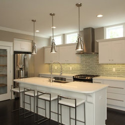 Elongated Hexagon Tile Back Splash Adds Elegance To This Transitional