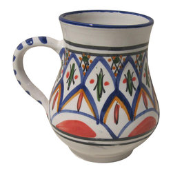 Le Souk Ceramique - Tabarka Large Mug - Set of 4 - Set of 4. 16 Fluid Ounces. Hand Made . Dishwasher safe . Microwave safe . Made in Tunisia. Lead free glazes . Meets CA Prop 65 . Meets all Federal StandardsNamed in part for the beautiful Tunisian seaside resort town of Tabarka where the red tile roofs of the Mediterranean beach bungalows dot the coastline, our Tabarka pattern is an elaborate blend of Italian, French and Arabic styles that throughout history have also shaped it's namesake city. Shades of fire red, goldenrod, grass green and cobalt blue are set against a white background creating a sumptuous and vibrant pattern perfect for any occasion.