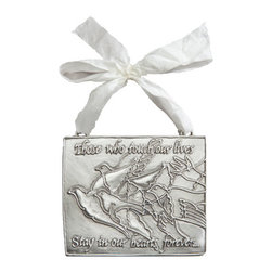 "Exposures - Remembrance Ornament - Overview Christmas is a time of remembrance for those who are here, as well as those who have passed. This pewter ornament commemorates the lasting impact of the important people in our lives. Hang the ornament on your tree or wall to remember someone you lost this year, or give as a gift to a grieving loved one. This ornament will serve as a tasteful, comforting reminder of a special person who has passed away. Inscribed with the reassuring verse, ""Those who touch our lives stay in our hearts forever.""  Features Pewter ornament Ivory hanging ribbon Comes in a gift box with a story card    Specifications  3"" wide x 2 3/4"" high"