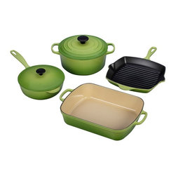 Le Creuset - Le Creuset Palm 6 Piece Signature Set - MS1406-4P - Shop for Cookware Sets from Hayneedle.com! Choose green cookware with the Le Creuset Palm 6 Piece Signature Set. Throwaway sets end up in the landfill but this set is made to be enjoyed by future generations. Each piece offers the impressive heat distribution properties of cast iron with easy enameled surfaces that never need seasoning and resist dulling staining sticking and burning. Cast iron is ideal for hours of low slow cooking and retains heat to keep foods hot longer. The exterior surfaces in Palm are engineered to resist cracking and chipping. Easily see when foods are done with sand-colored enamel within the roaster saucier and French oven. The Skillet Grill features Satin Black enamel that is also made to release foods easily and to cook at higher temperatures for browning searing and caramelizing. All surfaces are ready to use out of the box; no seasoning required. Each handle is thoughtfully made to offer secure purchase even with oven mitts. Heat and flavor can't escape thanks to secure-fitting lids. Quart for quart this set offers the lightest cast iron you'll find. All pieces are dishwasher safe and washable with warm soapy water.Additional Features:Saucier knob is heat safe to 375 FFrench oven knob is heat safe to 500 FSet weighs 38.8 lbs.4 1/2 Qt. French Oven measures 6.75H x 10 diam. in.5 1/4 Qt. Roaster measures 15.75L x 10.25W x 3H in.Square Skillet Grill offers a 10W x 10L x 1.75H in. cooking surface5 1/4 Qt. Roaster measures 16.5L x 95W x 5H in.Made in France About Le Creuset of America Inc.From its cast iron cookware to its teakettles and mugs Le Creuset is a global standard of inimitable color and quality. Founded in 1925 in the northern French town of Fresnoy-Le-Grand Le Creuset still produces enameled cast iron in its original foundry. Its signature color Flame was modeled after the intense orange hue of molten cast iron within a cauldron (or creuset in French) and has been a Le Creuset bestseller from the company's first year to the present day.Though best known for its vibrantly colored cookware and original inventions such as the Dutch oven Le Creuset has also forged a name as a creator of stoneware mugs and enamel-coated stainless steel teakettles. The style and performance of Le Creuset's Cafe Collection and tea accessories are rooted in classic French cookware: bold colors cylindrical loop handles unmatched thermal resistance and heat distribution and of course the iconic Le Creuset three-ring accent. Through its consistent qualities of authenticity originality and innovation Le Creuset maintains a connection to both heritage and modernity.