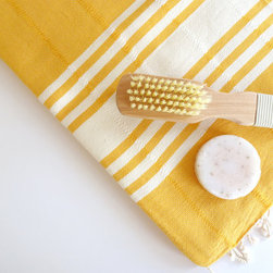Elegant Turkish Towel, Dark Yellow by The Anatolian - Turkish hammam towels are popping up everywhere these days, and I love them. They come in a variety of colors, some subdued and others, like these, full of rich color. Throw a bunch in a basket in a guest bathroom or use them outdoors poolside.