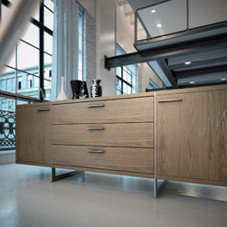 Greenwich Sideboard - Greenwich two-door, three-drawer dining buffet. Finished in luxurious wenge or walnut veneer with the direction of the grain articulating the different sections, this striking buffet appears to be suspended from the stainless steel legs which run from top to floor. Each inside cabinet measures 14.75W x 16D x 18.5H, equipped with a fixed center shelf. Available in wenge or walnut wood finishes. Arrives assembled. Imported.