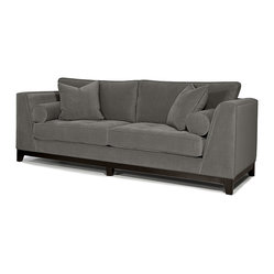 Younger - Max Sofa, Wooden Base - The Max sofa has got some snappy mod style, with a clean, straight outline accented by smart, slanted angles that point outward like a crisp bowtie. Classic looking and comfy too, with foam-cushioned seats under a smooth gray upholstery, he sits handsomely on a dark wood base.