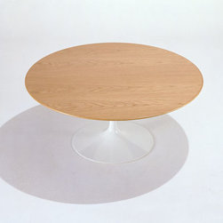 "Eero Saarinen - Saarinen Round Coffee Table - Saarinen Round Coffee Table by Knoll   designed by Eero Saarinen The Eero Saarinen Coffee Tables are first and foremost pure tables. They are the work of an essentialist, boiling concepts and functions down to their invaluable attributes. The Saarinen Coffee Tables are effective and beautiful structures, but never showy or unnecessary ones. From Saarinen himself: ""The underside of typical chairs and tables makes a confusing, unrestful world. I wanted to clear up the slum of legs."" To accomplish this, the Saarinen Coffee Tables are on a pedestal, unencumbered by the ""slum of legs,"" and easy to use for the whole family.  The tables are available with veneer, laminate, or marble tops with a base in black, white or the new platinum 50th Anniversary finish."