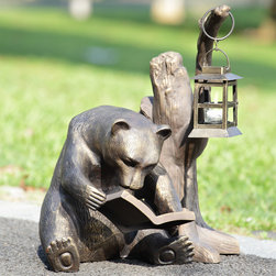 "Booklover Bear Garden Lantern - The big guy has a very nice set-up for nocturnal reading. Aluminum garden accent does double duty as a studious growler and an outdoor or accent lantern. That ""bears"" repeating! Dimensions: 17.5""w x 15.5""d x 19.5""h"