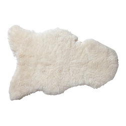 Sheepskin Throw - There is nothing cozier than a sheepskin draped on a comfortable chair. Besides, Christmas is the perfect time to embrace winter clichés.