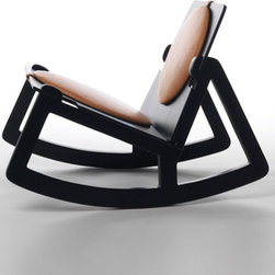 Low Rider Rocker - By design, this is not your average rocking chair. The solid wood base provides rocking comfort with the appeal of contrast, while its feet have been crafted so no rocker will flip backwards. Add contrast to your home study's color palette with the Low Rider Rocker.