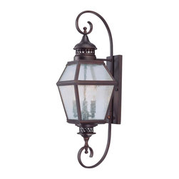 """Savoy House - Chiminea 8"""" Steel Wall Mount Lantern - A New Orleans inspired outdoor style that is destined to become a bestseller, crafted to mimic the appearance of an antique gas lantern. The English Bronze finish and pale cream seeded glass add to the families tremendous value."""