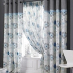 Seamed Fabric with Grommet Curtains & Draperies of Indianapolis- Custom Styles a - This is a picture of grommet draperies.  We like this style for a modern, contemporary or transitional look. The printed fabric with the seamed solid color adds visual interest to your curtains. Plus having the top portion different will bring your eyes up and make your ceilings feel taller.