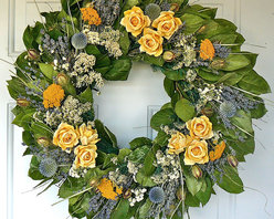 "Frontgate - Yellow Rose Wreath - 22"" dia. - Organic roses made of Mulberry paper. Designed for interior use. Extend the life of floral materials by keeping it away from direct sunlight and moisture. A Frontgate exclusive. Like a glorious burst of sun, our Yellow Rose Wreath will effortlessly enhance any interior space. Made of dried lavender, nigella, yarrow, globe thistle and more, this classic design has the zest of a great garden, without any of the work.  .  .  .  . Made in the USA."