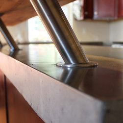 Bar Brackets - Riser brackets are a sleek way to add a raised bar to a countertop. Natural hardwood and concrete look great together. Photo by Kingbird Design