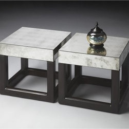 Butler Bunching Table - Butler Loft - A design that emphasizes opposites, the Butler Bunching Table - Butler Loft's combination of dark color and reflective light will give character to any room. This contemporary-style bunching table is made from solid gmelina (and other wood products), with a combination of ebony and Butler Loft finishes. Smoked mirror-glass completes the top and sides of the piece. Buy singly for to accent your decor, or in multiple to bring a new theme to your home. Piece requires no assembly and is ready to display on arrival.About Butler SpecialtyButler Specialty Company has been designing and manufacturing high-quality occasional and accent furniture since 1930. Each piece reflects Butler's dedication to enduring design, exquisite craftsmanship, and top-quality materials. This family-owned company is based in Chicago. They scour the globe in search of the finest materials and most efficient means of production, reflecting their commitment to providing excellent quality at exceptional value.