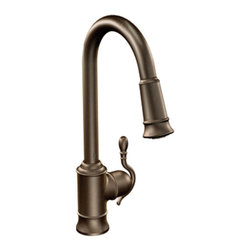 "Moen - Moen S7208ORB Woodmere High-Arc 1-Handle Pull-Down Bar Faucet, Oil-Rubbed Bronze - Moen's 7208ORB is part of the Woodmere collection. Moen's 7208ORB has an Oil Rubbed Bronze finish. Moen's 7208ORB is a new style high Arc Pulldown Bar/Prep Faucet. Moen's 7208ORB mounts in a 1-hole sink, has an 8 3/4"" long and 16 7/8"" high arc spout, with a full 9 9/16? from deck to aerator. Moen's 7208ORB single lever handle provides ease of operation. When filling vessel outside of the sink, the pause feature conveniently stop the flow of water as the wand passes over the countertop. Moen's 7208ORB is part of the Woodmere kitchen collection. The Woodmere collections flowing design provides an uncluttered appearance to your countertop. Moen's 7208ORB Pulldown Bar/Prep faucet has convenient handle reversibility feature, and single-button actuation provides flexibility to switch from stream to spray mode. Moen's 7208ORB Wand has Hydrolock quick connect system and includes 68? braided hose. Oil Rubbed Bronze is an exclusive finish from Moen and provides style and durability. Moen's 7208ORB metal lever handles meets all requirements of ADA ASME A112.18.1/CSA B125.1, NSF 61/9 Proposition 6"". Limited Lifetime Warranty."