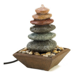 KOOLEKOO - Zen Stacked Stone Fountain - The sound of water cascading over perfectly balanced stacked stones makes this a welcome meditation destination in your home. This fountain features multi-colored stones resting on a bed of pebbles, collected in a simple and lovely wood-liked base.