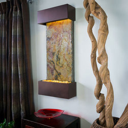 "Bluworld - Falling Leaves VerticalLightweight Slate Fountain - Oil Rubbed Bronze - Our Falling Leaves slate showcases the beautiful swirling colors of fall, warm and inviting reminiscent of ""falling leaves"". The Oil Rubbed Bronze trim is a sophisticated semi-matte finish certain to blend with any decor. The vertical fountain panel is made of genuine slate bonded with a composite material for an extremely lightweight design that can be installed in 30 minutes or less. Water gently flows down the Falling Leaves slate face into a basin filled with polished river rocks. Easily adjust the flow of water with the included flow valve. The dimmable, remote controlled LED lighting highlights the soft cascade of water creating a dramatic focal point in any room or office.Falling Leaves Vertical includes long-lasting super bright white LED lights rated for over 10,000 hours of use and an ergonomic finger slide remote control to easily dim or brighten the LED lights or turn them on and off. This water fountain glistens as water sheets over the genuine Indian Slate flowing passed polished river rock creating a soothing sound and beautiful focal point for any room. This fountain is engineered with Bluworld's clog-free, splash-free design and features the Water Wonders NSI�� genuine light weight Slate. Installation is super easy with the lightweight nature of the NSI�� slate panels. Simply hang on the wall per the instructions. Once it's installed, your only concerns are setting the flow rate and turning on the accent light with your handy remote.This water fountain can be customized with your logo. Etched and hand-painted logos start at only $395.00. Contact our sales department for more information at 1-888-499-5433.Free freight is only available in the 48 Contiguous United States. Please contact us so that we can provide you with a quote when shipping to Alaska, Hawaii, other US territories or international."