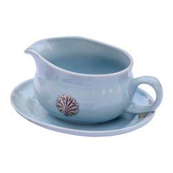 Coquille Gravy Boat - Mist - Nobility is the controlling notion in the design of the Mist Coquille Gravy Boat, a necessity of formal table service that brings a soft soapstone hue to the setting with its reactive glaze.  A pewter scallop-shell medallion, dimensional and elegant, brings out the cool greys within this delicate translucent tone while conveying splendor to the look.