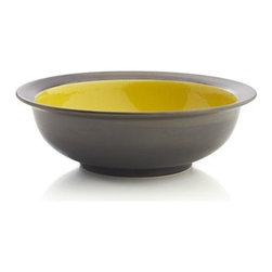 Sol Bowl - Sunny, glossy yellow interiors radiate warmth in casual, rounded shapes and bold rims, glazed bronzy brown. Patterning of reactive glazes will vary from piece to piece.