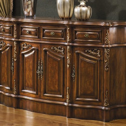 Monterey Credenza - Monterey credenza in Antique Walnut finish with gold accent. Credenza constructed from solid walnut wood with carefully carved curve side panels and fitted with quality brass hardware.