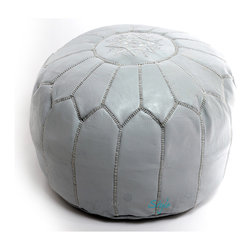 """Moroccan Pouf, Gray/Grey Leather Pouf, Round Ottoman Foot Stool Pouffe - Moroccan Poufs are wonderful leather ottomans used for seating. This type of furniture can go by many names, such as hassock, tuffet , and of course ottoman. Outside the United States it's more commonly spelled """"Pouffe"""". These lovely round ottomans have many different uses. For example it's an excellent foot stool or foot rest and a lovely piece of furniture or housewares; however it's mainly used for seating. A Moroccan Pouffe makes for an excellent piece of home decor. We hand process our Moroccan poufs by the same traditions that remain unchanged for centuries and were passed down through families for generations. We use an earth-friendly process to produce these poufs this includes using natural dyes and sunlight to tan the hides. We embroider colorful hand stitched designs onto the leather pouffe. We create new ideas to design new styles that bring trend to the world of home decor and design. A Moroccan Pouf can come in a large variety of colors sizes and styles from simple plain designs to intricate and embroidered designs. As much as these leather poufs are useful, this type of furniture can bring a nice addition and provide seating to any room whether inside homes, restaurants, hotels, clubs, and much more, it's a beautiful piece of home decor."""