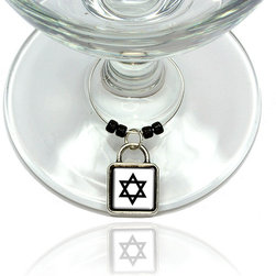 """Made on Terra - Star of David Wine Glass Silver Charm - Your guests have arrived and the atmosphere is electric. A sip of wine here, a sip of a cocktail there and you find the conversation turning to the charming baubles you've placed on the glasses, something special you chose for each of your eclectic guests. They love them and appreciate your thoughtfulness. You love them for their uniqueness and that no one forgets which glass they were using.  Choose from Made on Terra's many designs for the best party ever. Ring is 1"""" diameter; measures 2"""" from top of ring to bottom of charm. Made of metal and plastic. Sold individually."""