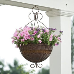 Round Resin Wicker Hanging Basket with Metal Hanger - The graceful curls of this planter will create a perfect complement to spreading blooms. The Resin Wicker Hanging Basket with Metal Hanger features a woven resin basket and an elegant metal hanger. The basket has the vintage beauty of wicker, but it's actually made of a durable, weather-resistant PVC resin. The resin is hand-woven on a sturdy powder-coated metal frame for extra stability and long-lasting resilience. Ideal for outdoor use, the resin material will stand up to the elements as it provides a happy home for your plant. The basket is available in two sizes and various colors and includes a coco fiber liner for healthy drainage. Ready for planting, this artistic basket will make a lovely addition to your patio, porch, or awning. SIZE DIMENSIONS:14 in. Basket: 14W x 14D x 24H inchesWeight: 6 lbs.16 in. Basket: 16W x 16D x 26H inchesWeight: 8 lbs.About DMC ProductsDMC Products has developed a reputation as one of the leading manufacturers of unique products for the home and garden. They are committed to designing and producing great-looking products with undeniable consumer value. They are constantly working on new and innovative products to enhance your home or business. DMC products cares about your health and the environment. They are proud to say that they do not use lead-based paints or finishes on any of their products.Please note this product does not ship to Pennsylvania.