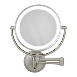 "Zadro - 10X/1X Satin Nickel Round LED Lighted Wall Mirror - The LED Lighted Round Wall Mirror features a dual-sided, premium quality mirror with two magnifications. On one side, a 10x magnification mirror allows you to see up-close and in detail, allowing for easy make-up application. The other side features a normal, 1x magnification mirror that is great for checking hair and make-up. The wall mirror lights up with energy-saving LED bulbs that illuminate your entire face, allowing you to see the finest details in even the dimmest lighting, and its cordless design allows you to mount it anywhere! The LED Lighted Round Wall Mirror is available in an elegant Satin Nickel finish. Features: -Wall mount mirror. -Satin nickel finish. -Dual sided LED lighted mirror. -10x - 1x Magnification. -Round shape. -Energy saving LED lighting consumes up to 70% less electricity than regular bulbs Dual-jointed wall mount with extendable arm. -360 Degree Swivel Mirror. -Operates on 4 ""C"" batteries or AC adapter (included). -Lifetime Eco-Friendly LED Bulbs Never Need Replacing. -Manufacturer provides 90 days warranty. Specifications: -Arm extends 12"". -Mirror surface dimensions: 7"" Diameter. -Overall Dimensions: 13.75"" Height x 11"" Width x 2.5"" Depth."