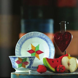 Americana & Folk Art Collection Jan 2013 - Antique spatterware cup and plate with stone fruit and a heart-shaped shooting gallery target make a handsome vignette.  Photo copyright Garth's Auctioneers & Appraisers