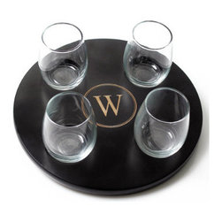 Grandin Road - Set of Four Personalized Wine Flight Glasses - Set includes monogrammed tray and four stemless wine glasses. Tray is crafted from smooth engineered wood, with a polished finish. Simply wipe tray clean with a damp cloth; glasses are conveniently dishwasher safe. Complimentary engraving with a single, uppercase block initial inside circle design, as shown (natural variation in engraving process means each initial will be unique). Sample your favorite red and white wines in elegant style with our Personalized Wine Flight Sampler with 4-piece Glass Set. Round tray is ingeniously designed with four circular notches carved directly into the wood for securely holding glasses during transport. What's more, we'll custom engrave the tray with your single monogram at no additional charge. Sampler includes four 5-1/2 oz. stemless wine glasses. Makes a spirited addition to wine tasting parties, as well as a wonderful gift.. . . . Personalized items are not returnable.