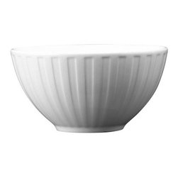 Wedgwood Night and Day Small Fluted Bowl - The Wedgwood Night and Day Small Fluted Bowl features an original 18th century Wedgwood design reimagined for contemporary tastes. Its bone china construction is safe for microwave or dishwasher, and its precisely etched lines give it a linear modern quality that's perfectly at home on breakfast bars or dining room tables.About WedgwoodThrough highly skilled craftsmanship and the highest quality standards, Wedgwood manufactures quality ceramics with sophisticated, classical, and contemporary design. With a tradition of innovation, quality, and craftsmanship, Wedgwood designs are widely acknowledged as timeless, elegant, classic, and understated. Their design teams work with external designers for cross-pollination of ideas and experience. Founded in 1759 by Josiah Wedgwood, Wedgwood has been an international company determined to uphold their standards in order to maintain their leadership in the world's markets. Though their roots are over two centuries old, the company strives to stay current through partnerships with fashion designers Jasper Conran and Vera Wang with whom they've developed contemporary and stylish ranges that appeal to the younger consumers.