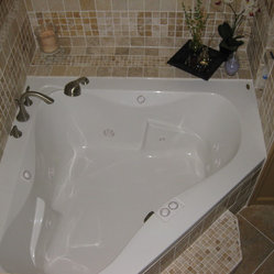 custom walk in shower and a jacuzzi tub installation with