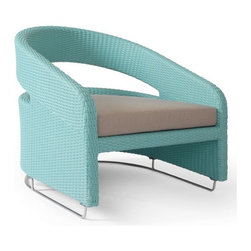 Lebello Modern Outdoor Wicker Patio Lounge Chair - This chair is contemporary but has a retro feel that reminds  me of the beach club in the movie The Flamingo Kid. I love it.