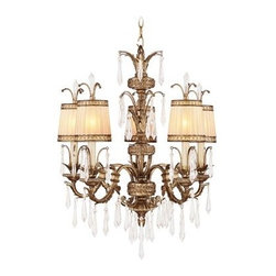 Livex La Bella 8805-65 Chandelier - Vintage Gold Leaf - 26W in. - Boasting fluid lines, graceful curves, and a traditional look that's designed to stand the test of time, the Livex La Bella 8805-65 Chandelier - Vintage Gold Leaf - 26W in. is just what you need to elegantly dress up your foyer or dining space. Crystal accents add a dash of femininity to the hand crafted, drum-shaped gold-dusted glass shades, which coordinate beautifully with the vintage gold leaf finish to create a fixture that's rich in both style and substance. This 26-inch chandelier uses five 60-watt candelabra base bulbs (not included) to fill your space with a warm, ambient glow. 36 inches of chain and 120 inches of wire are included for installation.About Livex LightingLivex Lighting is a manufacturer and distributor of decorative residential lighting. The company was founded in 1993 and is now headquartered in a 150,000-square-foot facility in Morristown, New Jersey. Livex Lighting currently offers over 2,500 products ranging from lighting fixtures for indoor and outdoor applications to lampshades, chandelier shades, ceiling medallions, and accent furniture. The goal of Livex Lighting is to provide the highest-quality product at the most affordable price. We are constantly responding to the ever-changing needs, styles, and fashions of the lighting industry while always maintaining the highest standards of quality.