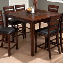 Jofran - Jofran Baroque Brown 7-Piece Counter Height Dining Table Set - JSI1159 - Shop for Dining Tables from Hayneedle.com! The warm full-bodied hue of burnished brown covers every inch of the Jofran Baroque Brown 7-Piece Counter Height Dining Table Set. This casual and contemporary collection includes six fully upholstered chestnut bonded leather pub chairs made from solid Asian hardwood and a matching counter-height table for them to gather around. The luxurious table features a square top with mosaic inlay and four straight legs with charcoal highlights on the edges. This is the perfect way to create a relaxed atmosphere in your kitchen.About Jofran FurnitureJofran is a seller of fine home furnishings based in Norfolk Mass. Launched in 1986 Jofran is known for the high-quality materials and meticulous methods that go into producing its products. Jofran furniture is easy-to-assemble and includes various styles from all around the world making it easy to find a piece that suits your home decor.