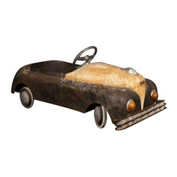 Used 1920's French Toy Car - An adorable vintage children's toy car. The body, frame, and wheels of the car are made of metal. There is little steering wheel mounted on a rotating axis that is in working condition. Rusted perfectly and in original patina!